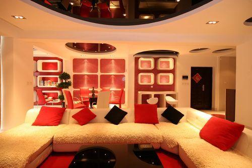 北京别墅装修设计——客厅 主要以白色现代的沙发为主 用红黑的抱枕做
