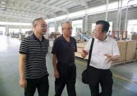 中國木材與木制品協會領導蒞臨千川木門視察調研
